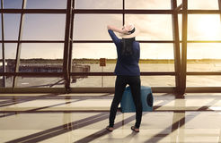 Portrait of asian woman carrying luggage while standing Royalty Free Stock Photo