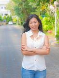 Portrait of an Asian woman chill out on a street. Present for relaxation activity in an urban life style Royalty Free Stock Photos