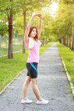 A portrait of a asian woman doing stretching exercise. Before or after jogging in the city park on the morning royalty free stock photos