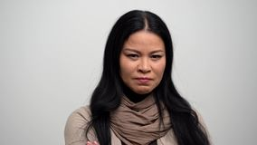 Portrait of angry Asian woman who breathes to calm down. Portrait Of Asian Woman Feeling Very Angry And Crossing Her Arms. Being Angry The Lonely Woman Breathes stock video footage
