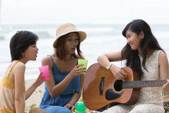 Portrait of asian woman and friends group playing guitar and hap Stock Photo
