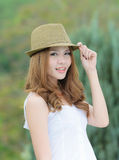 Portrait asian woman hat stand smiling in the park. Royalty Free Stock Images