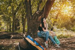 Portrait of Asian woman her smile trekking at forest royalty free stock photos