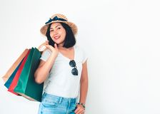 Portrait of asian woman is holding many shopping bags posing on royalty free stock images