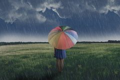 Portrait of asian woman holding umbrella on the green field stock photo