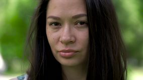 A portrait of a asian woman with an image in the eyes. Barely noticeable tears. Close-up. stock video