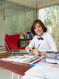 Portrait of Asian woman interior designer working Royalty Free Stock Photo