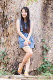 Portrait Asian woman lean a dry tree Royalty Free Stock Photos