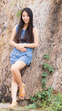 Portrait Asian woman lean a dry tree Stock Photos