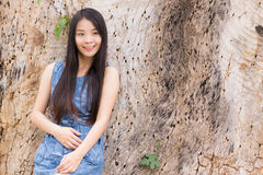 Portrait Asian woman lean a dry tree Royalty Free Stock Photo