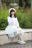 Portrait asian woman lolita dress on nature park. In close up stock images