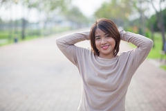 Portrait Asian woman in a park. Royalty Free Stock Photo