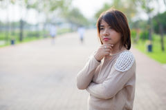 Portrait asian woman in park. Royalty Free Stock Photos