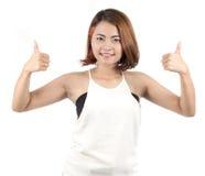 Portrait of Asian woman raise her thumbs. On White background Studio shot Royalty Free Stock Photos