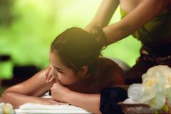 Portrait of Asian woman is relaxing in spa massage, Thai massage.  royalty free stock image