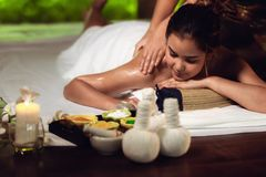 Portrait of Asian woman is relaxing in spa massage, Thai massage. Portrait of Asian woman is relaxing in spa massage., Thai massage royalty free stock photography