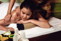 Portrait of Asian woman is relaxing in spa massage, Thai massage.  stock photos