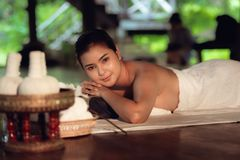 Portrait of Asian woman is relaxing in spa massage, Thai massage. Healthcare concept stock photos