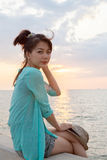 Portrait of asian woman relaxing vacation holiday at sea side wi Royalty Free Stock Photo
