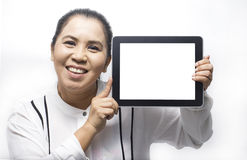 Portrait of Asian woman showing tablet computer Royalty Free Stock Images