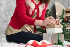 Portrait of asian woman sit near christmas tree at home. girl wi Royalty Free Stock Photography