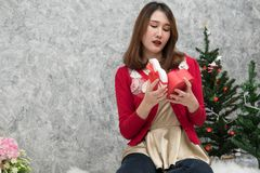 Portrait of asian woman sit near christmas tree at home. girl wi Stock Images