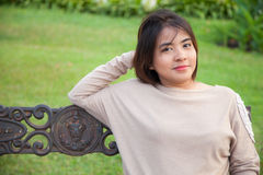 Portrait Asian woman sitting on the bench. Stock Photography