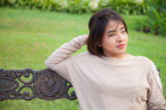 Portrait Asian woman sitting on the bench. Royalty Free Stock Image