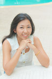 Portrait of an Asian woman sitting on a chair Royalty Free Stock Photo