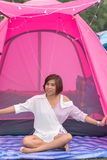 Portrait of Asian woman sitting in front of the pink tent , Dec royalty free stock photography