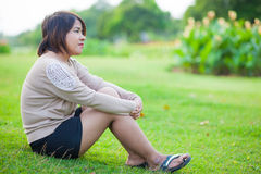 Portrait Asian woman sitting in the park. Royalty Free Stock Image