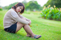 Portrait Asian woman sitting in the park. Stock Image