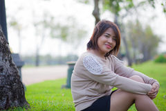 Portrait Asian woman sitting in the park. Stock Photography