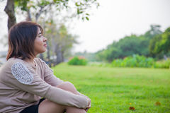 Portrait Asian woman sitting in the park. Stock Images