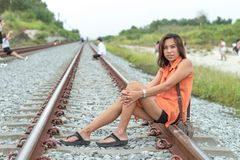 Portrait Asian woman sitting on the tracks. stock images