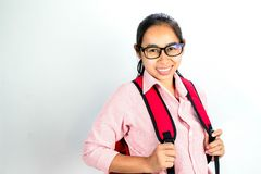Portrait of Asian woman smiling face, wearing glasses with a red bagpack, standing over white background with copy space stock images