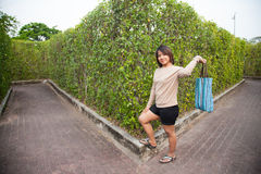 Portrait Asian woman Standing and holding bag Royalty Free Stock Images