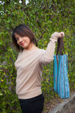 Portrait Asian woman Standing and holding bag Royalty Free Stock Image