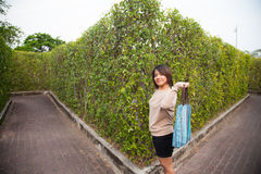 Portrait Asian woman Standing and holding bag Stock Photos