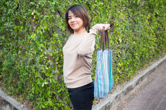 Portrait Asian woman Standing and holding bag Stock Photo