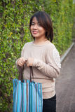 Portrait Asian woman Standing and holding bag Royalty Free Stock Photo