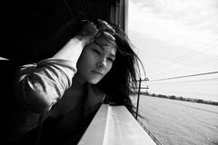 Portrait of asian woman. Travel by train Stock Images