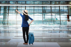 Portrait of asian woman travelling with suitcase Royalty Free Stock Photography