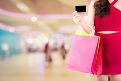 Portrait of asian woman wear red dress holding shopping bag Royalty Free Stock Image