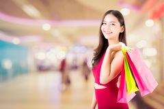 Portrait of asian woman wear red dress holding shopping bag Royalty Free Stock Photos