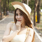 Portrait Asian woman wearing hat Stock Photo