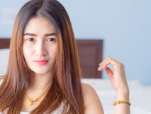 Portrait of Asian woman in white vest. Royalty Free Stock Photo