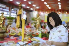 Portrait of Asian women worshiping the sacred parts of Buddhism royalty free stock photos