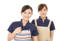 Smiling women in apron. Portrait of Asian women in apron stock photos
