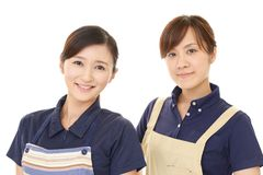 Smiling women in apron. Portrait of Asian women in apron royalty free stock photography